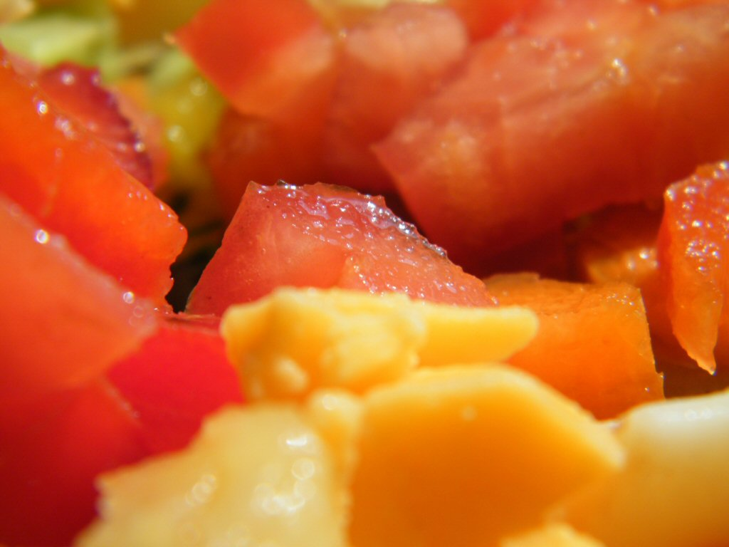 Macro Close Up of Colorful Parts of a Salad Diced Up Strawberry and Cheese