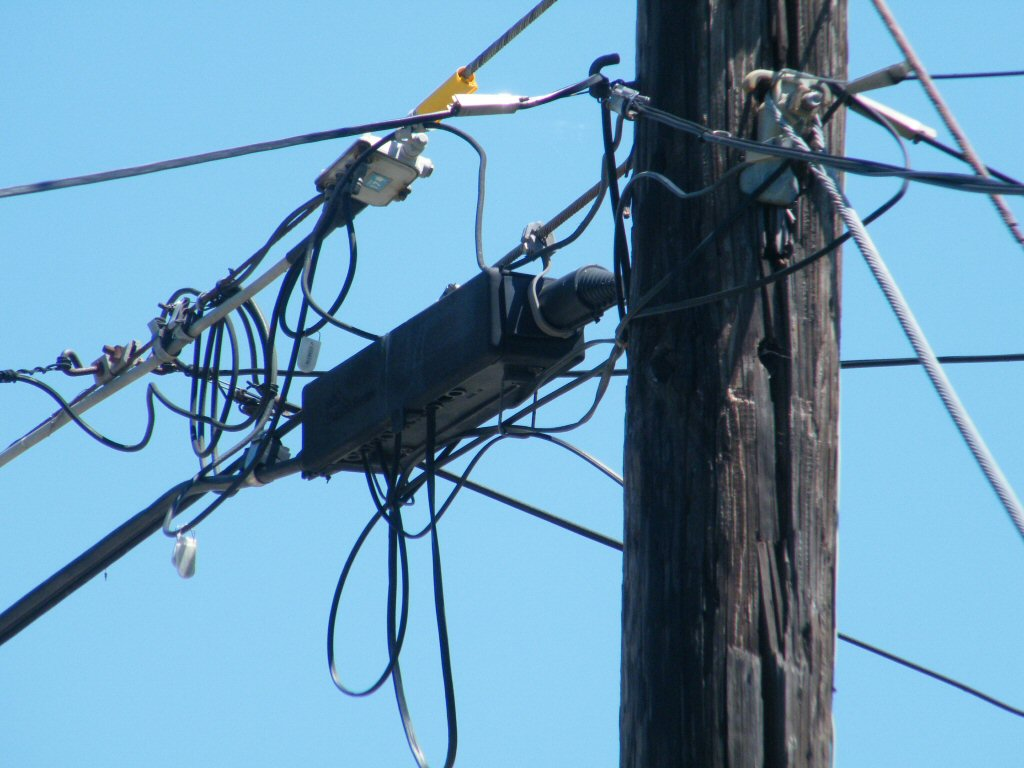 Zooming In on a Telephone Pole with a Complete Mess of Wires